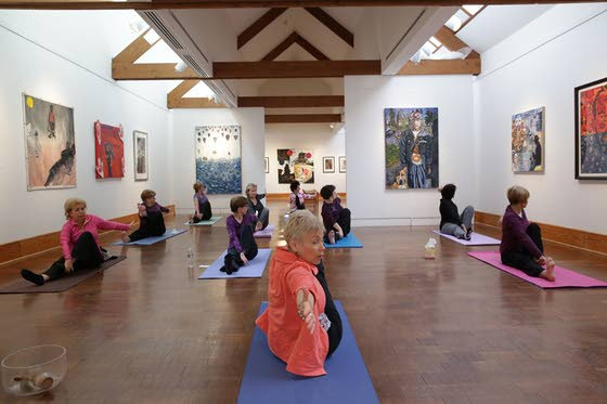 Practicing the art of yoga while surrounded by art