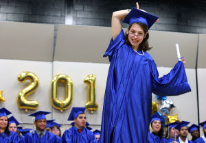 Atlantic Special Services Graduation: Ashlee Kaspar, of Mays Landing, moves her tassel, Friday June 13, 2014, during the Atlantic County High School commencement ceremony in Mays Landing. - Michael Ein