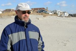Still Anti Dune After Sandy: Glenn Klotz, of Margate, stands by the dunes at Huntington Avenue, in Margate. Glenn Klotz, of Margate, is one of the last members of the anti-dune group DUNE still living in the area. He is also one of the few remaining anti-dune people in the area, even after Sandy. Wednesday, January, 23, 2013( Press of Atlantic City/ Danny Drake)
