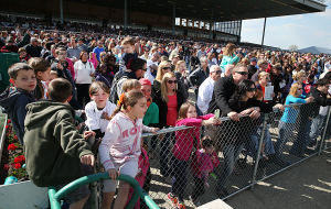 Day At The Races: The large crowd presses the fence to watch the racing action. Sunday April 27 2014 Live turf racing at the Atlantic City Racecourse in Mays Landing. (The Press of Atlantic City / Ben Fogletto) - Ben Fogletto