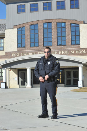 INCREASING PATROLS: Ptl. Bob Sheppard, of the Egg Harbor Township police department walks in front of Egg Harbor Township High School, Friday Jan. 18, 2013. In the wake of last months Newtown, Conn. school massacre the township has stepped up patrols and is working with schools and other public facilities to ensure safety. (The Press of Atlantic City/Staff Photo by Michael Ein)  - Michael Ein