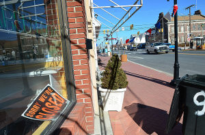 Downtowns In The Velocity Zone: A closed sign sits in the window of the empty Avera's Bakery store on Ventnor Avenue. Monday February 18 2013 Margate's downtown is right in the middle of a bowl-shaped depression that is part of the proposed velocity zone on the new FEMA flood maps - one of the few in the area to do so. (The Press of Atlantic City / Ben Fogletto)  - Ben Fogletto