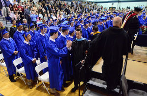 St. Augustine Graduation: Faculty members high five graduates as they enter for the graduation ceremony. Sunday May 19 2013 St. Augustine Prep Graduation. (The Press of Atlantic City / Ben Fogletto)  - Photo by Ben Fogletto