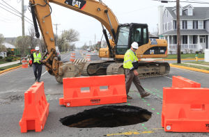 Sinkhole: Repair crew on the scene working on the sinkhole at 20th Street and Bay Avenue, in Ocean City at noon.  - Vernon Ogrodnek