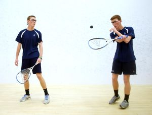 St. Augustine Squash Match: St. Augustine's Alexander Clark, 16, left and Benjamin Clark, 16 , right both from Northfield warm up before their squash match against St. Joe Prep of Philadelphia at Greate Bay Racquet & Fitness in Somers Point Tuesday, Feb, 18, 2014. - Edward Lea