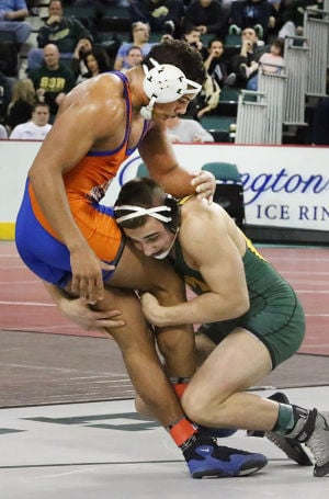 State Wrestling Tournament: 195 lb - Ed Shockley of Millville (left), Anthony Caesar of Montgomery. Saturday March 8 2014 State Wrestling Championships at Boardwalk Hall Atlantic City. (The Press of Atlantic City / Ben Fogletto) - Ben Fogletto