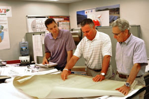 Calvi: Calvi Electric Co. President George Brestle, right, of Ventnor; his son Michael Brestle, center, of Margate, and project manager Brian Gemberling, look at blueprints of the company's California Avenue building in Atlantic City.