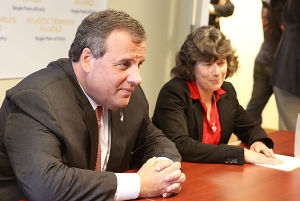 Christie Single Point Of Entry: Gov. Chris Christie and Atlantic Homeless Alliance director Ann Thoresen (right) meet with service organization representatives in a round-table discussion. Tuesday May 6 2014 NJ Gov. Chris Christie meets with with Organization representatives involved with the Single Point of Entry Program at the Atlantic County Municipal Building in Atlantic City. (The Press of Atlantic City / Ben Fogletto) - Ben Fogletto