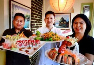 At Chaba Thai, Find Menu Variety And Spices Of Life: From left to right, Chatchai Suwannasin and owners Ben and Sandy Jintachao hold signature dishes at Chaba Thai & Sushi Restaurant in Linwood.