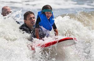 Surfers ride Ocean City waves to support programs for autism