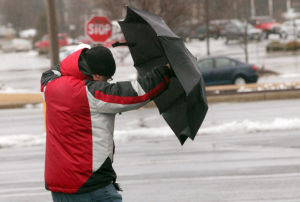 Storm Thurday: Matthew Kalodner, of Egg Harbor Township, struggles with his umbrella in the strong winds while in Somers Point during a coastal storm, Thursday morning, Feb., 13, 2014. - Vernon Ogrodnek
