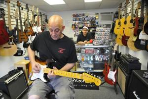 EHC restaurateur finds his relaxation in guitar shop