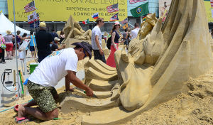 SAND SCULPTING: Sculptor Jooheng Tan of Singapore works on his entry. Sunday June 16 2013 World Championship of Sand Sculpting on the beach next to the Pier at Caesars in Atlantic City. (The Press of Atlantic City / Ben Fogletto)  - Ben Fogletto