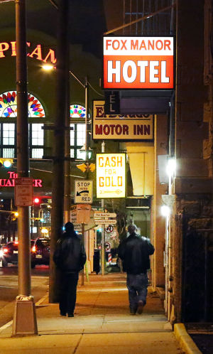 PACIFIC AVENUE PROSTITUTES: People walk past the Fox Manor Hotel on Pacific Avenue in Atlantic City. - Photo by Ben Fogletto