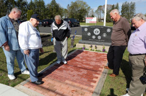 Nfield Veterans Park: From left, Mark Doherty, of Northfield, commander of the local America Legion post 295, Bob Webb, a Navy veteran from Northfield, Mayor Jerry McGee, Councilman Frank Perri, and Dennis Mahon, of Northfield, vice-commander of the legion post, at the veteran's park in Northfield where Webb put up statues representing US armed forces, Friday, May 2, 2014. The walkway has bricks dedicated to veterans, and two of them are Webbs. - Vernon Ogrodnek