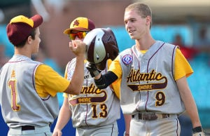 Atlantic Shore Celebrates: Atlantic Shore's Kyle Gerace, right, celebrates with teammate A.J. Russo, left, after scoring during the top of the fourth inning Monday. - Staff photo by Ben Fogletto