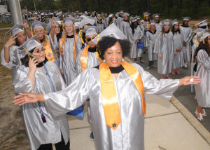 CCC GRADUATION: Tracy Gittens, 51, of Vineland, graduates with a secondary education degree during Cumberland County College 2014 graduation ceremony Thursday at Cumberland County College. - Dave Griffin