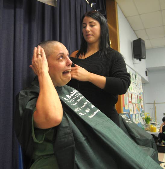 Sixth-grade teacher shaves her head, raising money to fight childhood cancer