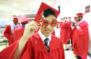 ACIT GRADUATION: Darwin Tran,18 of Atlantic City makes adjustment his grad glasses before the start of Atlantic County Institute of Technology Graduation Tuesday, June, 24, 2014. - Edward Lea