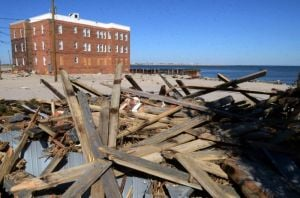 Sandy: Pieces of Boardwalk wood, washed away by Hurricane Sandy, sat in a pile at the end of Pacific Avenue, in Atlantic City in February. Homeowners in the region currently are finding out how much aid they are receiving. - Danny Drake