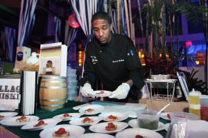 Men R' Cookin' Event: Chef Derrick Walker of Village Whiskey Revel set up his food during 13th annual Men R' Cookin' event, a fundraiser for the Boys & Girls Club of Atlantic City at Pool at Harrah's Thursday, Feb 20, 2014. - Edward Lea