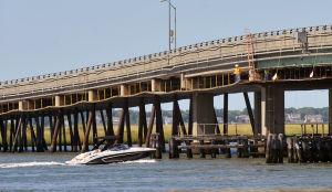 LONGPORT BRIDGE: A boat passes under the Longport Bridge, Friday Sept. 6, 2013. One lane of the bridge is closed due to work. (Staff Photo by Michael Ein/The Press of Atlantic City) - Michael Ein