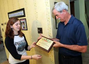 Absecon girl recognized for new love of reading