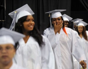 ATLANTIC CITY GRADUATION: Quadjira Carpenter, 18, of Atlantic City, wipes away tears as she arrives at the Atlantic City High School graduation ceremony , Wednesday June 19, 2013, at Boardwalk Hall in Atlantic City. (The Press of Atlantic City/Staff Photo by Michael Ein)  - Photo by Michael Ein