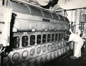 Cape May-Lewes Ferry 12.jpg: June 20, 1978. A mechanic aboard the M.V. New Jersey, part of the fleet of the Cape May-Lewes Ferry Service, performs maintenance tasks in the engine room. Press photo by Tom Kinnemand Jr. Historical photo archives