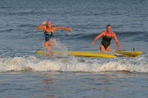 Women Lifeg: Wildwood Crest's Maryanne Lerro, left places first in Box Paddle board over Stone Harbor's Hayley Edwards , right during Ocean City Beach Patrol Women's Invitational Wednesday, July 24, 2013. - Edward Lea