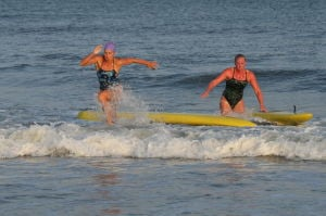 Women Lifeg: Wildwood Crest's Maryanne Lerro, left places first in Box Paddle board over Stone Harbor's Hayley Edwards , right during Ocean City Beach Patrol Women's Invitational Wednesday, July 24, 2013. - Photo by Edward Lea