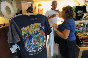 Margaritaville: Dave Bernhardy and Diane Camaroto, both of Monroe Township in Middlesex County, purchase t-shirts, Friday May 17, 2013, at Jimmy Buffett's Margaritaville gift shop at Resorts Casino Atlantic City. (The Press of Atlantic City/Staff Photo by Michael Ein)  - Michael Ein