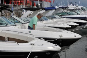 BOAT SHOW: Richa Diamond, of Media, Pa., looks at new boats by Chaparral Friday at the Atlantic City In-Water Power Boat Show at Frank S. Farley Marina. - Michael Ein