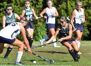 Mainl Field Hoc: Mainland 1 Angela Robbins (right) fights for ball control with AC 25 Lauren Stinson during the first period. Monday September 23 2013 Mainland at Atlantic City girls Field Hockey. (The Press of Atlantic City / Ben Fogletto) - Ben Fogletto