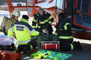 AIRPORT DISASTER DRILL: Firefighters remove