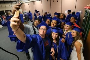 CHARTER TECH. GRADUATION: Josh Chesney, 18 , left of Egg Harbor Township front row takes a selfie photo along Carol Pacentrilli, 18 Ventnor front row Adrianna Hill, 18 of Galloway township front row and Ashley Fazio, 17, right of Egg Harbor township front row before the start of Charter-Tech High School Graduation at Tighe School Performing Arts Center in Margate Friday, June 20, 2014. - Edward Lea