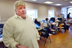 Downtowns In The Velocity Zone: Sales rep Michael McMenamin talks inside Marketplace Realty on Ventnor Avenue as employees work at folding desks until the build is complete. Monday February 18 2013 Margate's downtown is right in the middle of a bowl-shaped depression that is part of the proposed velocity zone on the new FEMA flood maps - one of the few in the area to do so. (The Press of Atlantic City / Ben Fogletto)  - Ben Fogletto
