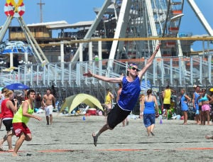 Wildwoods Beach Frisbee: Brian Chernak of Rochester NY leaps for a frisbee. Saturday July 27 2013 Wildwoods Beach Frisbee Tournament on the beach at Poplar Avenue. (The Press of Atlantic City / Ben Fogletto) - Ben Fogletto