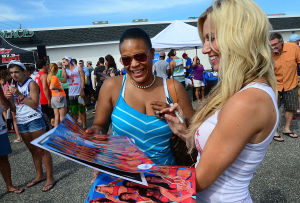 76ers Beach Bash: Lysandra Bracy of Berlin NJ has a poster signed by 76ers' cheerleader Brittony at the 76ers' Annual Beach Bash at Jack's Place in Avalon, Saturday July 27 2013. (The Press of Atlantic City / Ben Fogletto) - Photo by Ben Fogletto