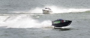 AC Power Boats: Typhoon 29 make the turn during the first race. Sunday June 23 2013 Atlantic City Offshore Grand Prix powerboat race off the beach in Atlantic City. (The Press of Atlantic City / Ben Fogletto)  - Ben Fogletto