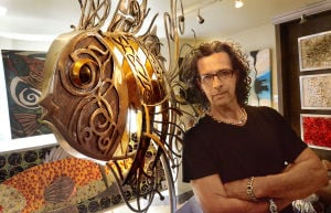 Chora: Jose Chora of EHT with one of his metal sculptures at his studio in Somers Point. Friday August 2 2013 (The Press of Atlantic City / Ben Fogletto) - Photo by Ben Fogletto