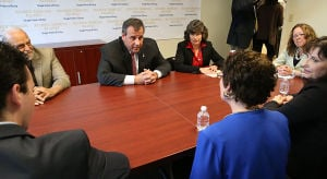 Christie Single Point Of Entry: Gov. Chris Christie and Atlantic Homeless Alliance director Ann Thoresen (center) meet with service organization representatives in a round-table discussion. Tuesday May 6 2014 NJ Gov. Chris Christie meets with with Organization representatives involved with the Single Point of Entry Program at the Atlantic County Municipal Building in Atlantic City. (The Press of Atlantic City / Ben Fogletto) - Ben Fogletto