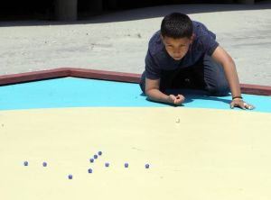 Marbles Tournament Kicks Off In Wildwood And Other Things To Enjoy At The Shore Today: William Portalatin 11, shoots during the competition. Wildwood schools will finally have students to compete in this years national marbles tournament in June. The schools held a mini tournament at Ringer Stadium on the beach, to see who goes to nationals. Monday May 13, 2013. (Dale Gerhard/The Press of Atlantic City)