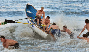 Bill Kuhn Brigantine Races: Ventnor's Dillan Turner and Louis Berges are pushed out by teammates during the Surf Boat Relays. Monday July 8 2013 Chief Bill Kuhn Brigantine Beach Patrol Invitational Races in Brigantine. (The Press of Atlantic City / Ben Fogletto) - Ben Fogletto