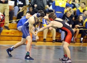 District 32 Wrestling: Johnathan Perez of Atlantic City's, left battle against Cameron Andres of Ocean City's, right during 132 lb. wrestling match at District 32 Wrestling Tournament at Absegami High School Friday, Feb 21, 2014. - Edward Lea