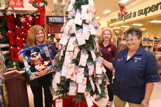 Volunteers in local gift tree programs work to make sure every child gets a holiday present