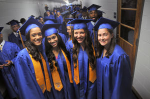Buena Graduation: Emely Ramirez, 19, Roshni Petal, 17, Chelsy Seelman, 17, and Sydney Zorzi, 18, all from Buena, are ready to graduate with their classmates during Buena Regional High School's Graduation ceremony held at Buena Regional High School in Buena Vista Township Tuesday, June 18, 2013. Photo/Dave Griffin  - Photo by David Griffin