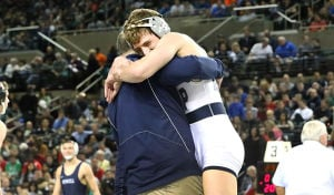 State Wrestling Tournament: 113 lb - Jack Clark of St. Augustine celebrates with coach after defeating Maaziah Bethea of Trenton Central in semi-final. Saturday March 8 2014 State Wrestling Championships at Boardwalk Hall Atlantic City. (The Press of Atlantic City / Ben Fogletto) - Ben Fogletto