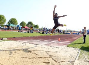 Atlantic County Track And Field Championships: Cedar Creek's Bo Melton first place long jump during Atlantic County track and field championships at Buena Regional High School Thursday, May, 8, 2014. - Edward Lea