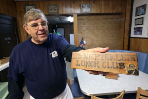 """Best Of The Press Aprl 30, 2014: Bob Essl, of Absecon, displays the """"Ed Nichterlein Lunch Club"""" plaque, Wednesday April 30, 2014, at his eatery Essl's Dugout in Egg Harbor Township. (Staff Photo by Michael Ein/The Press of Atlantic City) - Michael Ein"""